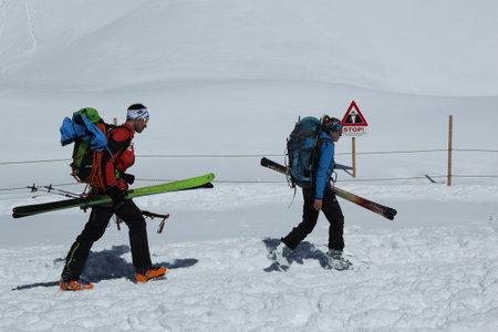 JUNGFRAUJOCH, SWITZERLAND - MAY 5, 2017: Unidentified tourists ready to ski at the Jungfraujoch Ski Region in  Switzerland.