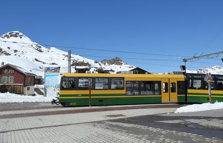 KLEINE SCHEIDEGG, SWITZERLAND - MAY 5, 2017: Kleine Scheidegg railway station situated on the summit of the Kleine Scheidegg Pass in the Bernese Oberland region of Switzerlandl at altitude 6762 Ft