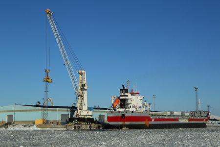 KEMI, FINLAND - FEBRUARY 17, 2017: General cargo ship Eemsborg docked in Port Kemi in frozen Baltic Sea