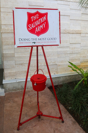 NASSAU, BAHAMAS - DECEMBER 6, 2017: Salvation Army red kettle for collections at Lynden Pindling International Airport terminal in Nassau, Bahamas. This Christian organization is known for its charity work, operating in 126 countries