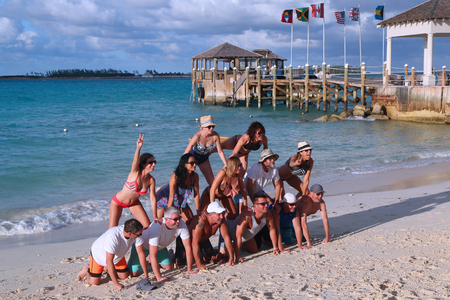 NASSAU, BAHAMAS - DECEMBER 4, 2017: Tourists have fun at the Cable Beach at the Sandals Royal Bahamian Luxury Resort in Nassau, Bahamas