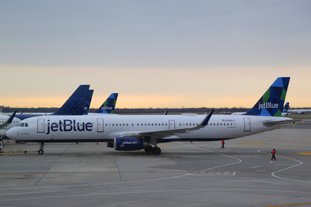 NEW YORK- DECEMBER 3, 2017: JetBlue plane on tarmac at John F Kennedy International Airport in New York Editorial