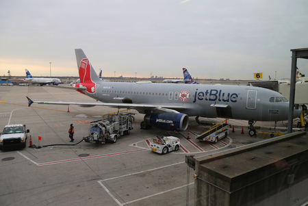NEW YORK- DECEMBER 3, 2017: JetBlue Red Sox-themed plane on tarmac at John F Kennedy International Airport in New York Editorial
