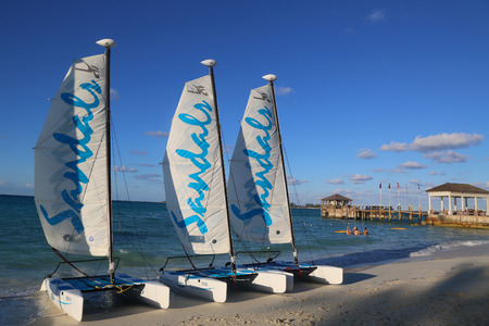 NASSAU, BAHAMAS - DECEMBER 3, 2017: Sandals Hobie Cat catamaran ready for tourists at the Cable Beach at the Sandals Royal Bahamian Luxury Resort in Nassau, Bahamas