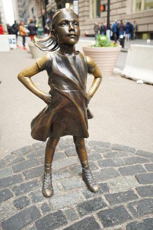 NEW YORK - DECEMBER 12, 2017: The Fearless Girl opposite the Charging Bull in lower Manhattan Manhattan.