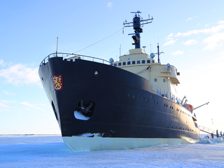 KEMI, FINLAND - FEBRUARY 18, 2017: Arctic Icebreaker Sampo during unique cruise in frozen Baltic Sea. The Sampo Icebreaker has been carrying tourists on Arctic adventures since 1988. 報道画像