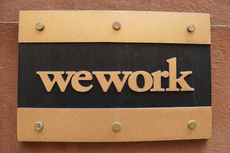 NEW YORK - DECEMBER 12, 2017: WeWork office in Manhattan. WeWork is an American company which provides shared workspaces, technology startup subculture communities, and services for entrepreneurs Editorial