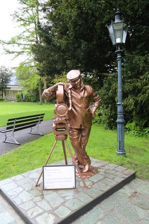 INTERLAKEN, SWITZERLAND - MAY 8, 2017: Bollywood film director and film producer Yash Chopra statue in front of  Historic Casino Kursaal in Interlaken, Switzerland