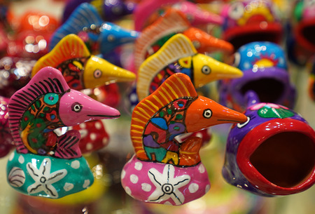 PLAYA DEL CARMEN, MEXICO - JANUARY 3, 2018: Local souvenirs on display at beach market in Playa Del Carmen, Mexico