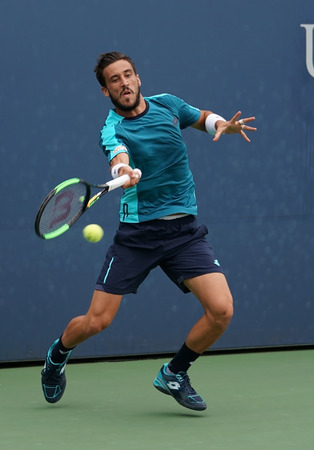 NEW YORK - SEPTEMBER 2, 2017: Professional tennis player Damir Dzumhur of Bosnia and Herzegovina in action during his US Open 2017 third round match at Billie Jean King National Tennis Center