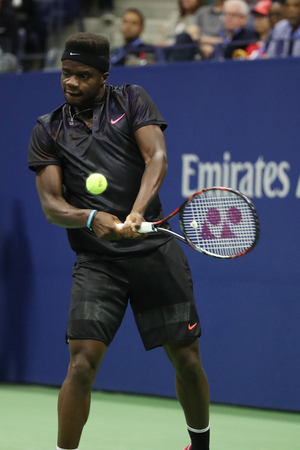NEW YORK - AUGUST 29, 2017: Professional tennis player Frances Tiafoe of United States in action during his US Open 2017 first round match at Billie Jean King National Tennis Center