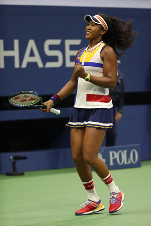 NEW YORK - AUGUST 29, 2017: Professional tennis player Naomi Osaka of Japan in action during her US Open 2017 first round match at Billie Jean King National Tennis Center