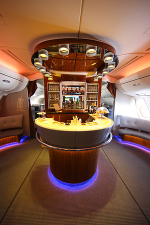 DUBAI, UAE - FEBRUARY 7, 2016: Emirates Airbus A380 in flight cocktail bar and lounge. Emirates is one of two flag carriers of the United Arab Emirates along with Etihad Airways and is based in Dubai