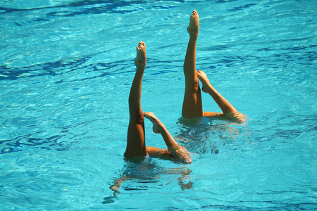 Synchronized swimming duet during competition Stock Photo