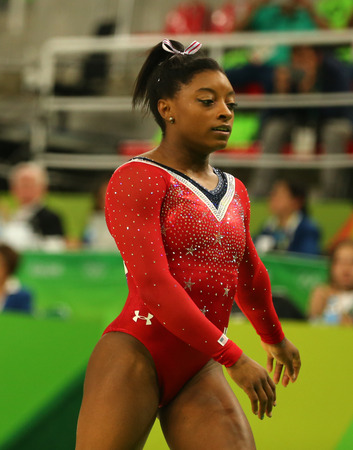 RIO DE JANEIRO, BRAZIL AUGUST 15, 2016: Olympic champion Simone Biles of United States competes at the final on the balance beam womens artistic gymnastics at Rio 2016 Olympic Games Publikacyjne