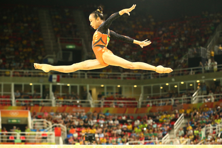 RIO DE JANEIRO, BRAZIL AUGUST 15, 2016: Artistic gymnast Fan Yilin of China competes at the final on the balance beam womens artistic gymnastics at Rio 2016 Olympic Games