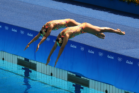 RIO DE JANEIRO, BRAZIL - AUGUST 15, 2016: Karem Achach and Nuria Diosdado of Mexico compete during the synchronized swimming duet technical routine preliminary round at the 2016 Summer Olympics