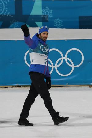 PYEONGCHANG, SOUTH KOREA - FEBRUARY 18, 2018: Olympic champion Martin Fourcade of France celebrates victory in biathlon mens 15km mass start at the 2018 Winter Olympics in Alpensia Biathlon Centre