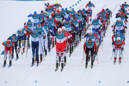 PYEONGCHANG, SOUTH KOREA - FEBRUARY 11, 2018: Mass start in the  Mens 15km + 15km Skiathlon at the 2018 Winter Olympics in Alpensia Cross Country Centre
