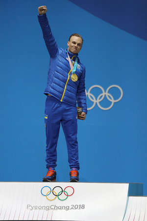 PYEONGCHANG, SOUTH KOREA  FEBRUARY 19, 2018: Olympic champion Oleksandr Abramenko of Ukraine celebrates victory in the Mens Aerials Freestyle Skiing in Medal Plaza Editorial
