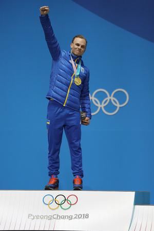 PYEONGCHANG, SOUTH KOREA  FEBRUARY 19, 2018: Olympic champion Oleksandr Abramenko of Ukraine celebrates victory in the Mens Aerials Freestyle Skiing in Medal Plaza Editöryel