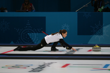 GANGNEUNG, SOUTH KOREA - FEBRUARY 10, 2018: Anastasia  Bryzgalova of Olympic Athlete from Russia competes in the Mixed Doubles Round Robin curling match at the 2018 Winter Olympics Editorial