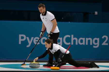 GANGNEUNG, SOUTH KOREA - FEBRUARY 10, 2018: Aleksandr Krushelnitskii and Anastasia Bryzgalova of Olympic Athlete from Russia compete in the Mixed Doubles Round Robin curling match at the 2018 Olympics