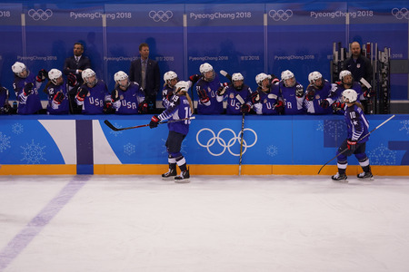 KWANDONG, SOUTH KOREA - FEBRUARY 13, 2018: Olympic champion Team USA scores against Team Olympic Athlete from Russia during Womens ice hockey preliminary round game Editorial