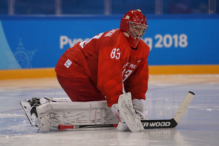 GANGNEUNG, SOUTH KOREA - FEBRUARY 17, 2018: Olympic champion and goalkeeper Vasili Koshechkin of Team Olympic Athlete from Russia warm up before Team USA Mens ice hockey preliminary round game