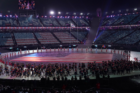 PYEONGCHANG, SOUTH KOREA  FEBRUARY 9, 2018: Olympic champion Erin Hamlin carrying the United States flag leading the Olympic team USA the PyeongChang 2018 Olympics opening ceremony Редакционное