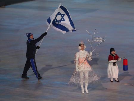 PYEONGCHANG, SOUTH KOREA  FEBRUARY 9, 2018: Figure  skater Alexey Bychenko carrying the Israeli flag leading the Olympic team Israel at  the PyeongChang 2018 Winter Olympics opening ceremony