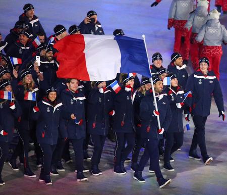 PYEONGCHANG, SOUTH KOREA  FEBRUARY 9, 2018: Olympic champion Martin Fourcade carrying the French flag leading the Olympic team France during the PyeongChang 2018 Winter Olympics opening ceremony Редакционное