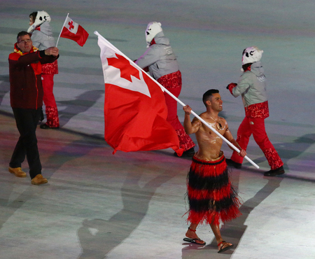 PYEONGCHANG, SOUTH KOREA  FEBRUARY 9, 2018: Tongan flag bearer Pita Taufatofua during the PyeongChang 2018 Winter Olympics opening ceremony