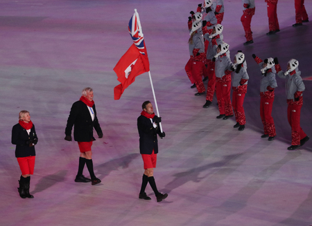 PYEONGCHANG, SOUTH KOREA  FEBRUARY 9, 2018: Bermudas only athlete and flag bearer Tucker Murphy with Bermuda flag at the PyeongChang 2018 Olympics opening ceremony Editorial