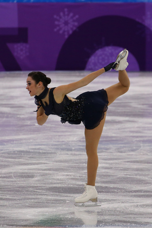 GANGNEUNG, SOUTH KOREA - FEBRUARY 11, 2018: Olympic champion Kaetlyn Osmond of Canada performs in the Team Event Ladies Single Skating Short Program at the 2018 Winter Olympics Editorial
