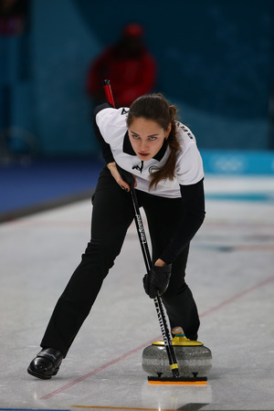 GANGNEUNG, SOUTH KOREA - FEBRUARY 10, 2018: Anastasia Bryzgalova of Olympic Athlete from Russia competes in the Mixed Doubles Round Robin curling match at the 2018 Winter Olympics at Gangneung Curling Editorial