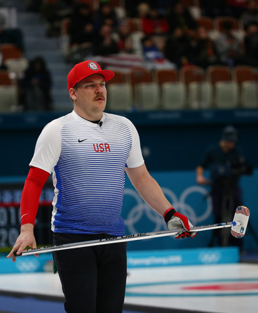 GANGNEUNG, SOUTH KOREA - FEBRUARY 10, 2018: Olympic Champion Matt Hamilton of United States competes during a mixed doubles round robin curling match at the 2018 Winter Olympics