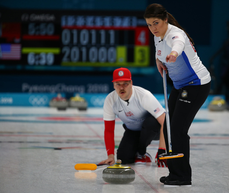 GANGNEUNG, SOUTH KOREA - FEBRUARY 10, 2018: United States siblings Matt (R), and Becca Hamilton compete during a mixed doubles curling match against Chinas Wang Rui and Ba Dexin at the 2018 Winter Olympics