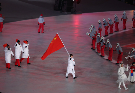 PYEONGCHANG, SOUTH KOREA - FEBRUARY 9, 2018: Olympic champion Yang Zhou carrying People Republic of China flag leading the Olympic team China at the PyeongChang 2018 Winter Olympics opening ceremony