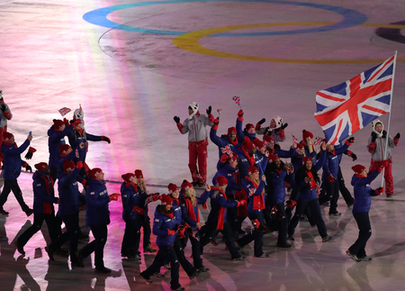 PYEONGCHANG, SOUTH KOREA - FEBRUARY 9, 2018: Olympic champion Lizzy Yarnold carrying the British flag leading the Olympic team Great Britain at the PyeongChang 2018 Winter Olympics opening ceremony Editorial