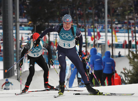 PYEONGCHANG, SOUTH KOREA - FEBRUARY 12, 2018: Olympic champion Anastasiya Kuzmina of Slovakia (number 13) competes in biathlon womens 10 km pursuit at the 2018 Winter Olympics in Alpensia Biathlon Centre