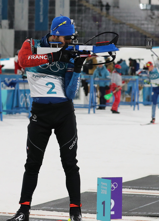 PYEONGCHANG, SOUTH KOREA  - FEBRUARY 18, 2018: Olympic champion Martin Fourcade of France competes in biathlon mens 15km mass start at the 2018 Winter Olympics in Alpensia Biathlon Centre Editorial