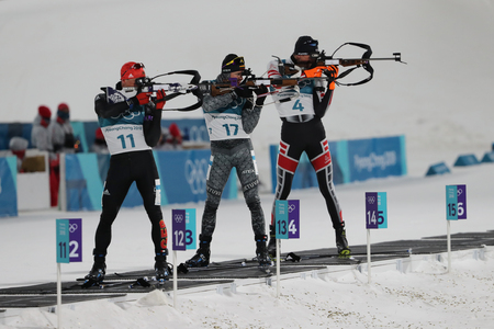 PYEONGCHANG, SOUTH KOREA - FEBRUARY 12, 2018: At the shooting range during the biathlon Mens 12.5km Pursuit at the 2018 Winter Olympics in Alpensia Biathlon Centre Redactioneel