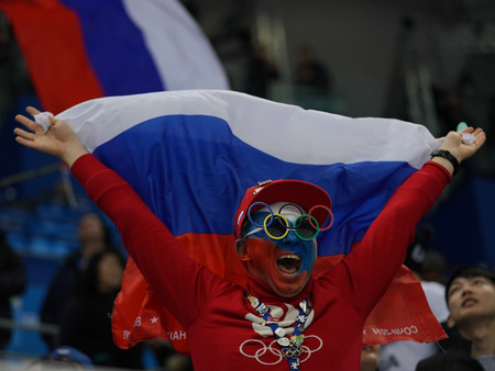GANGNEUNG, SOUTH KOREA - FEBRUARY 17, 2018: Russian hockey fan during Men`s ice hockey preliminary round game between Team USA and Team Olympic Athlete from Russia at 2018 Winter Olympics