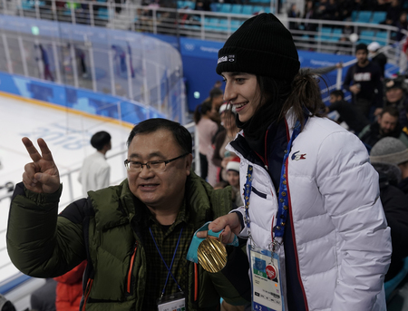 KWANDONG, SOUTH KOREA - FEBRUARY 14, 2018: Olympic champion in Ladies Moguls Perrine Laffont of France posing with gold medal at Mens ice hockey preliminary round game in Kwandong Hockey Centre