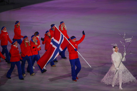PYEONGCHANG, SOUTH KOREA - FEBRUARY 9, 2018: Emil Hegle Svendsen carrying the flag of Norway leading the Olympic team Norway at the PyeongChang 2018 Winter Olympics opening ceremony