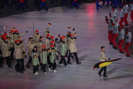 PYEONGCHANG, SOUTH KOREA - FEBRUARY 9, 2018: Eric Frenzel carrying the flag of Germany leading the German Olympic team at the PyeongChang 2018 Winter Olympic Games opening ceremony