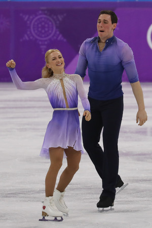GANGNEUNG, SOUTH KOREA - FEBRUARY 15, 2018: Olympic Champions Aljona Savchenko and Bruno Massot of Germany perform in the Pair Skating Free Skating at the 2018 Winter Olympics at Gangneung Ice Arena