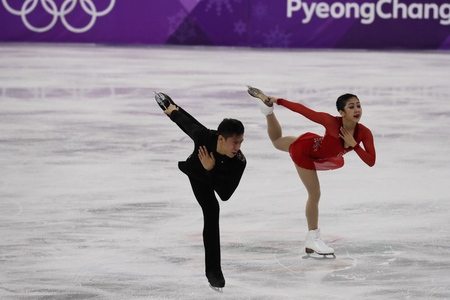 GANGNEUNG, SOUTH KOREA - FEBRUARY 15, 2018: Silver medalists  Wenjing Sui and Cong Han of China perform in the Pair Skating Free Skating at the 2018 Winter Olympic Games at Gangneung Ice Arena