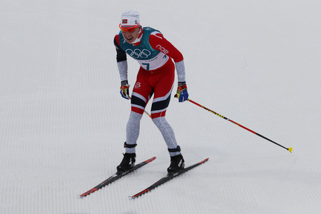 PYEONGCHANG, SOUTH KOREA - FEBRUARY 11, 2018: Olympic Champion  Simen Hegstad Krueger of Norway at finish line at mass start in the Mens 15km + 15km Skiathlon at the 2018 Winter Olympic Games